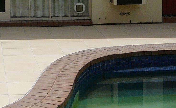 paving around pools using concrete, brick & stone pavers.