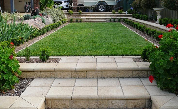 Sloping backyard after for Small patio landscaping