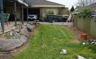 Sloping Backyard Before