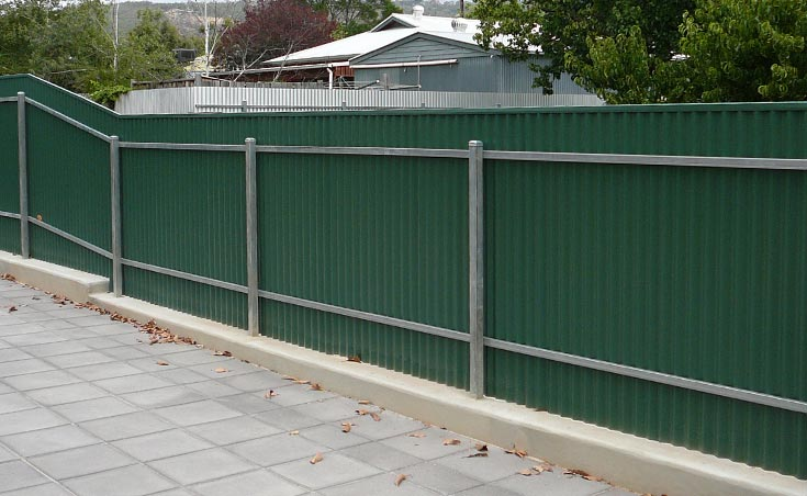 Post and Rail Fence On Concrete Plinth